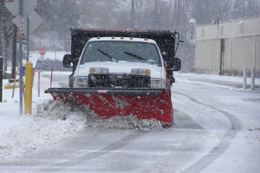 4x4 snow plow truck on the road - CSB Contractors, Inc.