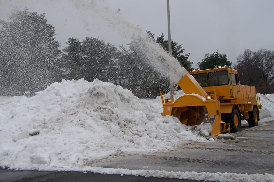 big snow pile by airport grade snow blower from CSB Contractors, Inc.