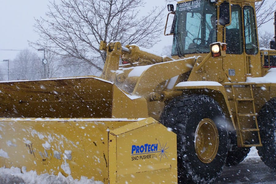 close up of wheel loader snow pusher - CSB Contractors, Inc.