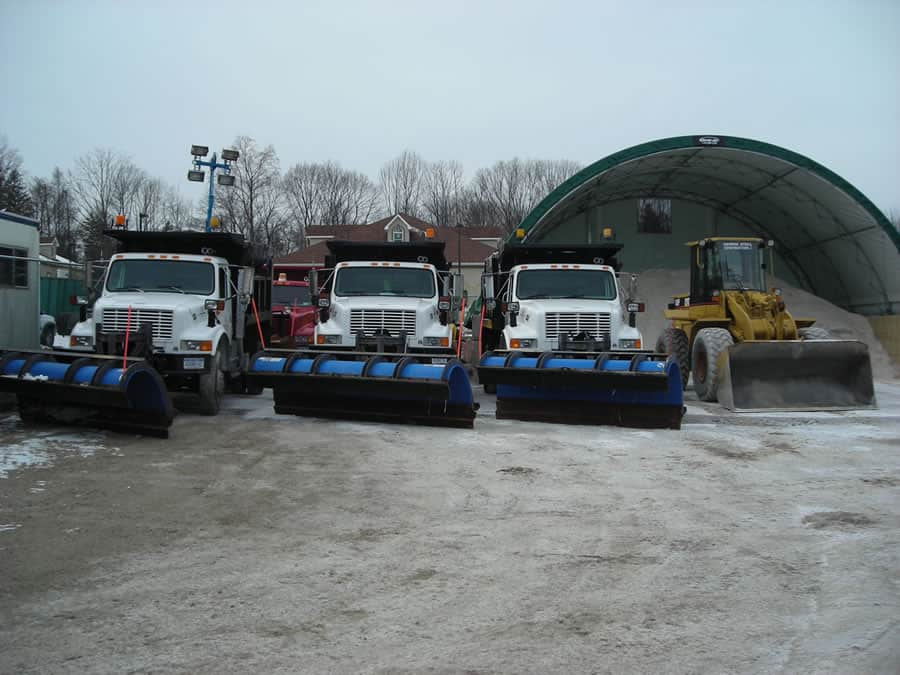 heavy duty snow plow trucks and rock salt pile from CSB Contractors, Inc.