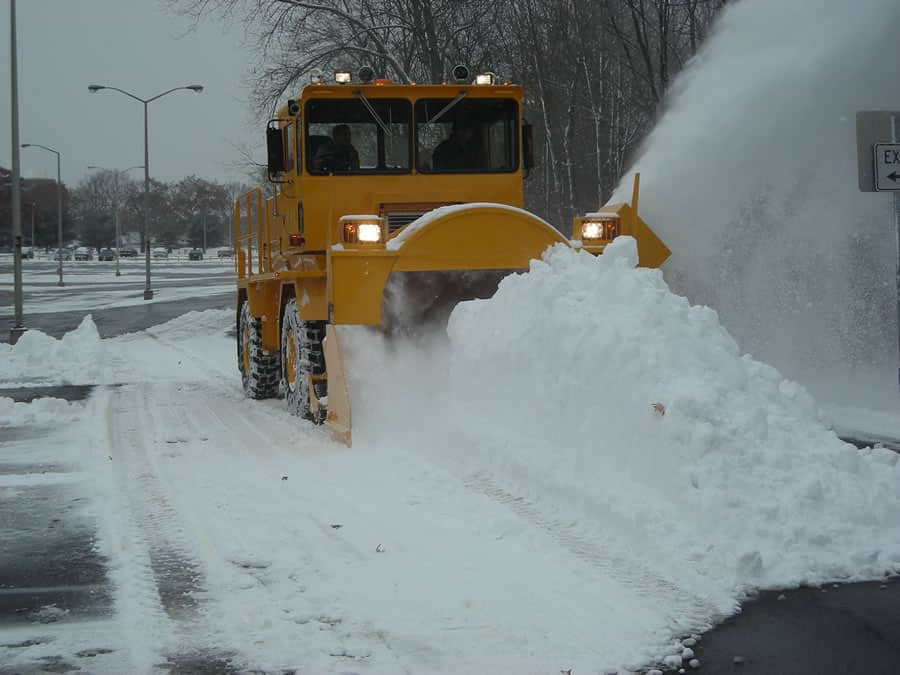 huge snow pile by airport grade snow blower from CSB Contractors, Inc.