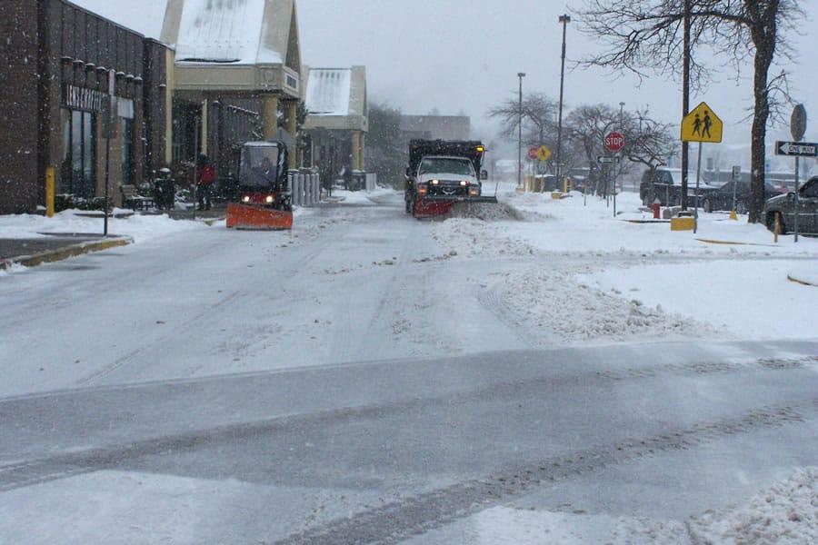 snow plow in action - CSB Contractors, Inc.