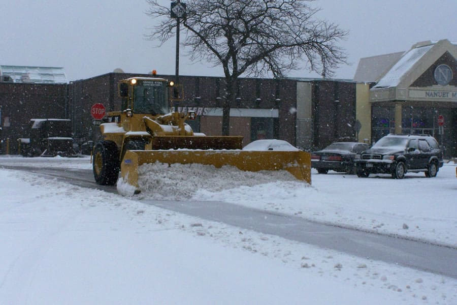 wheel loader snow pusher in action - CSB Contractors, Inc.