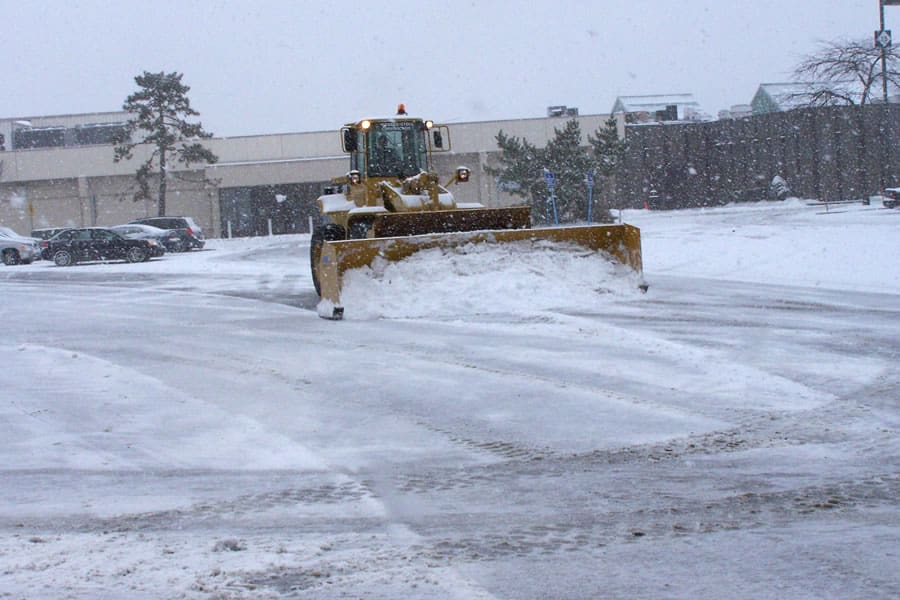 wheel loader snow pusher in lot - CSB Contractors, Inc.