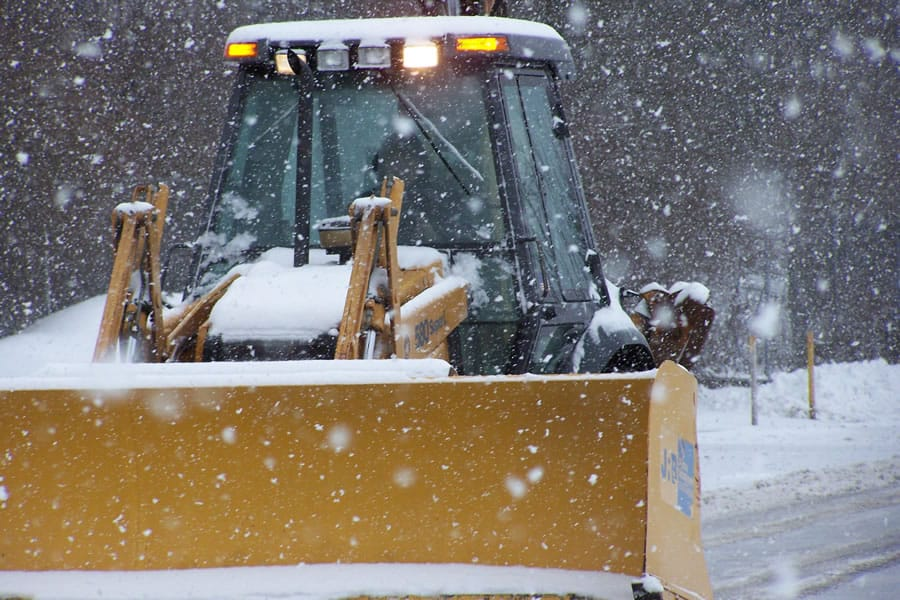wheel loader snow pusher in snow storm - CSB Contractors, Inc.