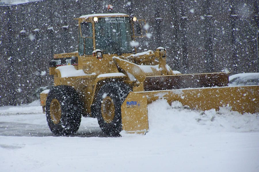 wheel loader snow pusher in storm - CSB Contractors, Inc.