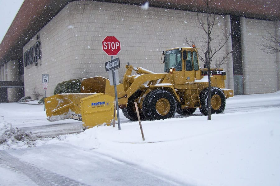 wheel loader snow pusher on street - CSB Contractors, Inc.