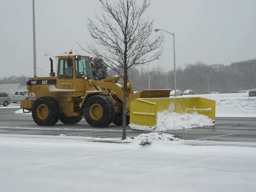 wheel loader with snow pusher doing snow removal from CSB Contractors, Inc.